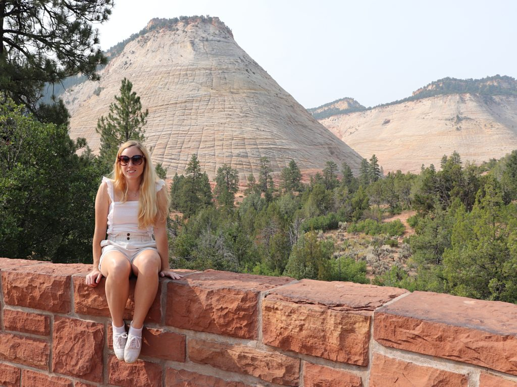 sitting on a wall in Zion